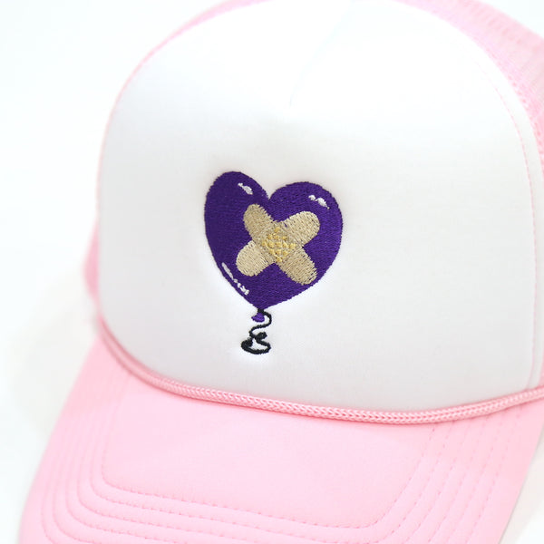 Damaged Goods Trucker Cap in Soft Pink
