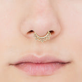 septum piercing. brass septum ring.