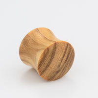 wood ear plugs. gauges. plugs. tunnels. organic plugs.