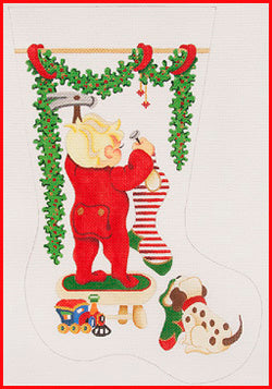 Boy on Stool Hanging Stocking with Train