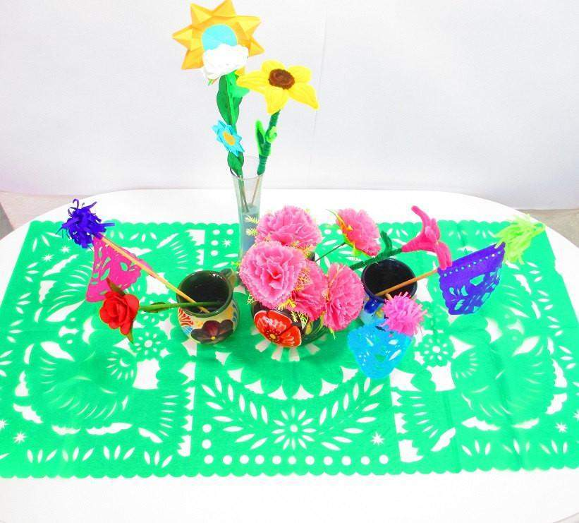 https://cdn.shopify.com/s/files/1/1073/8840/products/papel-picado-mexican-decorations-green-table-runner-papel-picado-fiesta-decoration-mexico-table-runner-1_2000x.jpg?v=1516314130