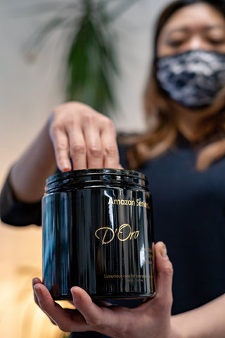 A Vancouver hairstylist dips her hand into a container of the Amazon D'Oro hair masque found at Fine Edge Supply