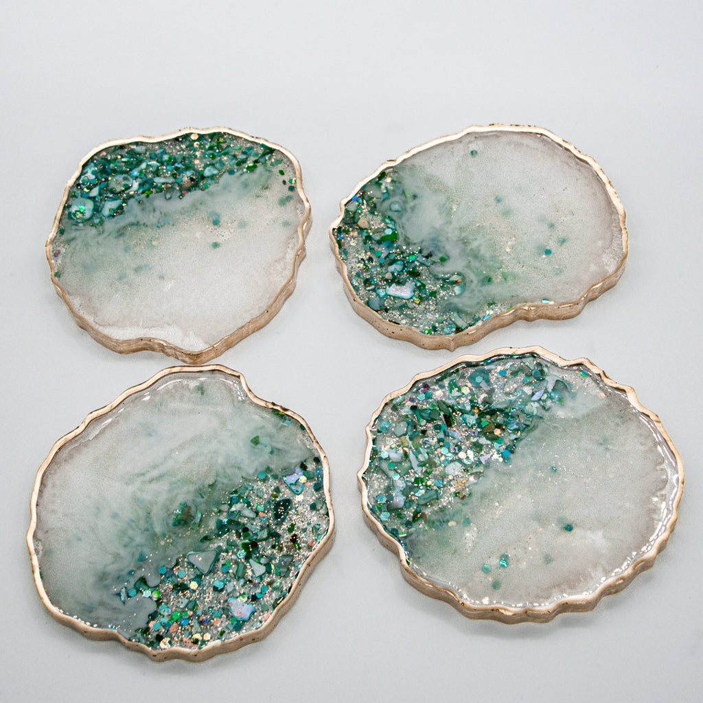 White Pearl Teal, Blue and Green Stones, Glitter and Shell Resin Coasters with Gold Edging.  Set of 4