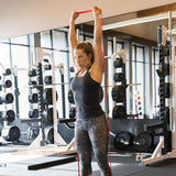 SKLZ Pro Bands Medium Product in use  - woman on stretch arm workout