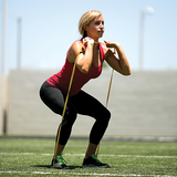 SKLZ Pro Band Light product in use - woman squatting - pulling band