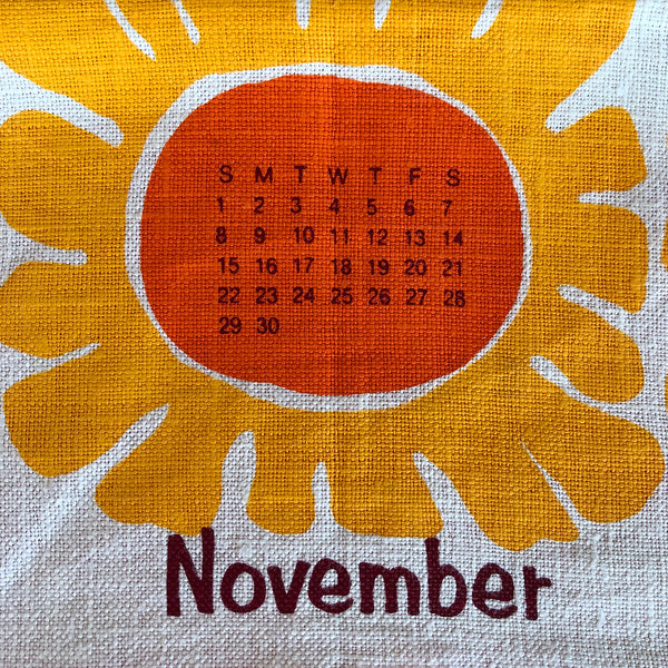1970 floral calendar cushion cover with added happiness
