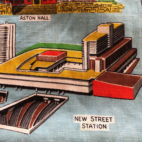 Detail view of new street station Birmingham teatowel repurposed into cushion cover