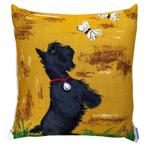 Scotty dog chasing butterflies in a vintage linen teatowel cushion cover