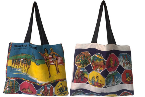 Surfers march past teatowel tote