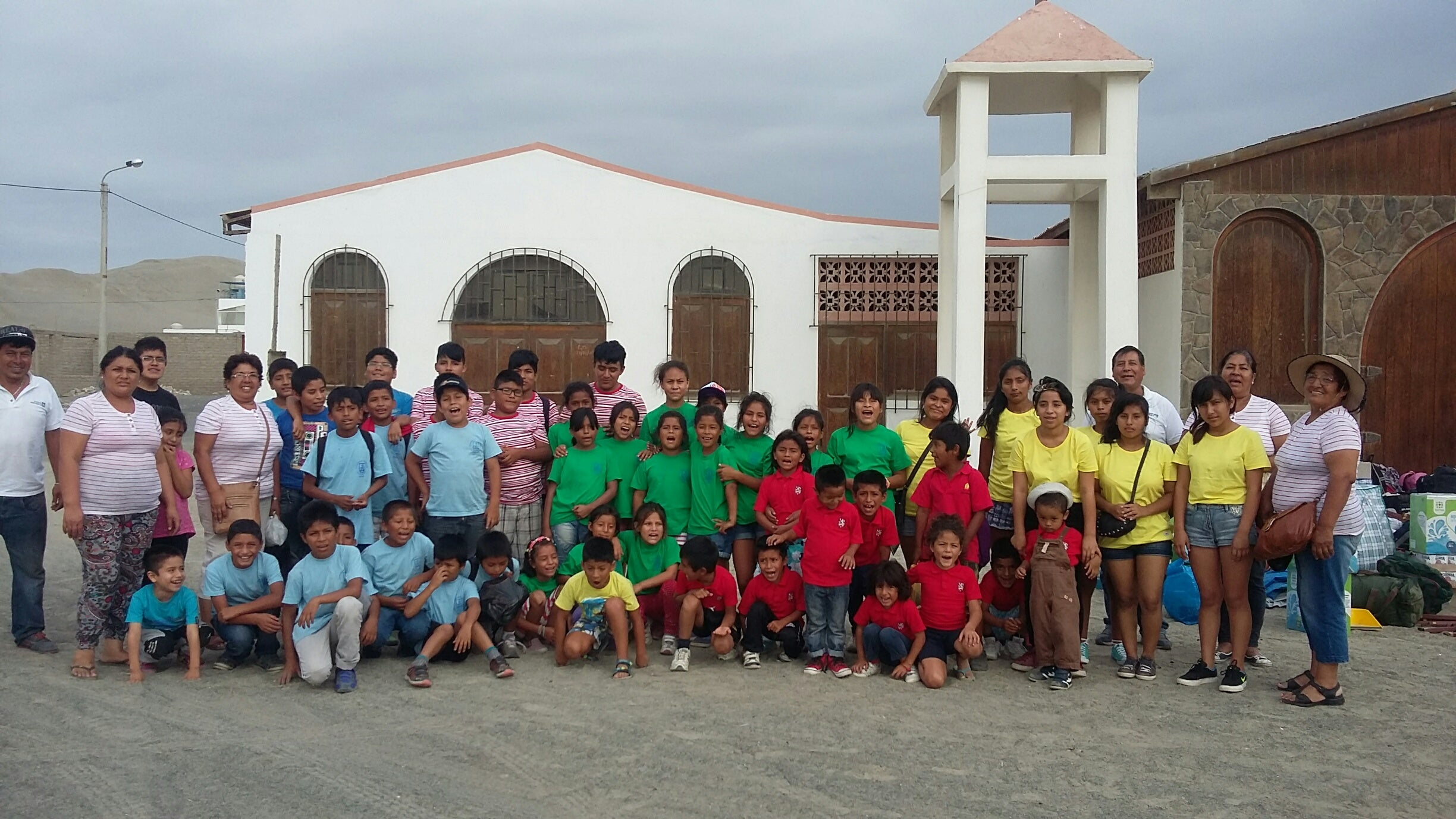 Beneficiaries of Project Peru wearing their donations from Finisterre