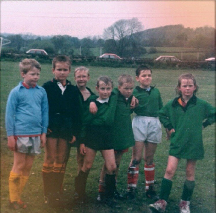 A young Sally McGee looks like she means business standing alongside her rugby teammates