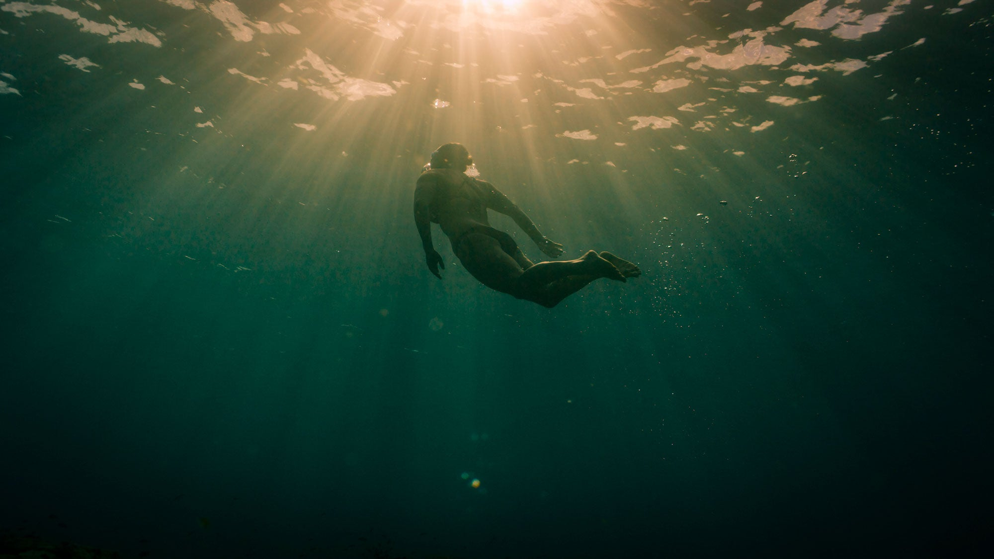 Beth French captured swimming underwater during her oceans 7 challenge