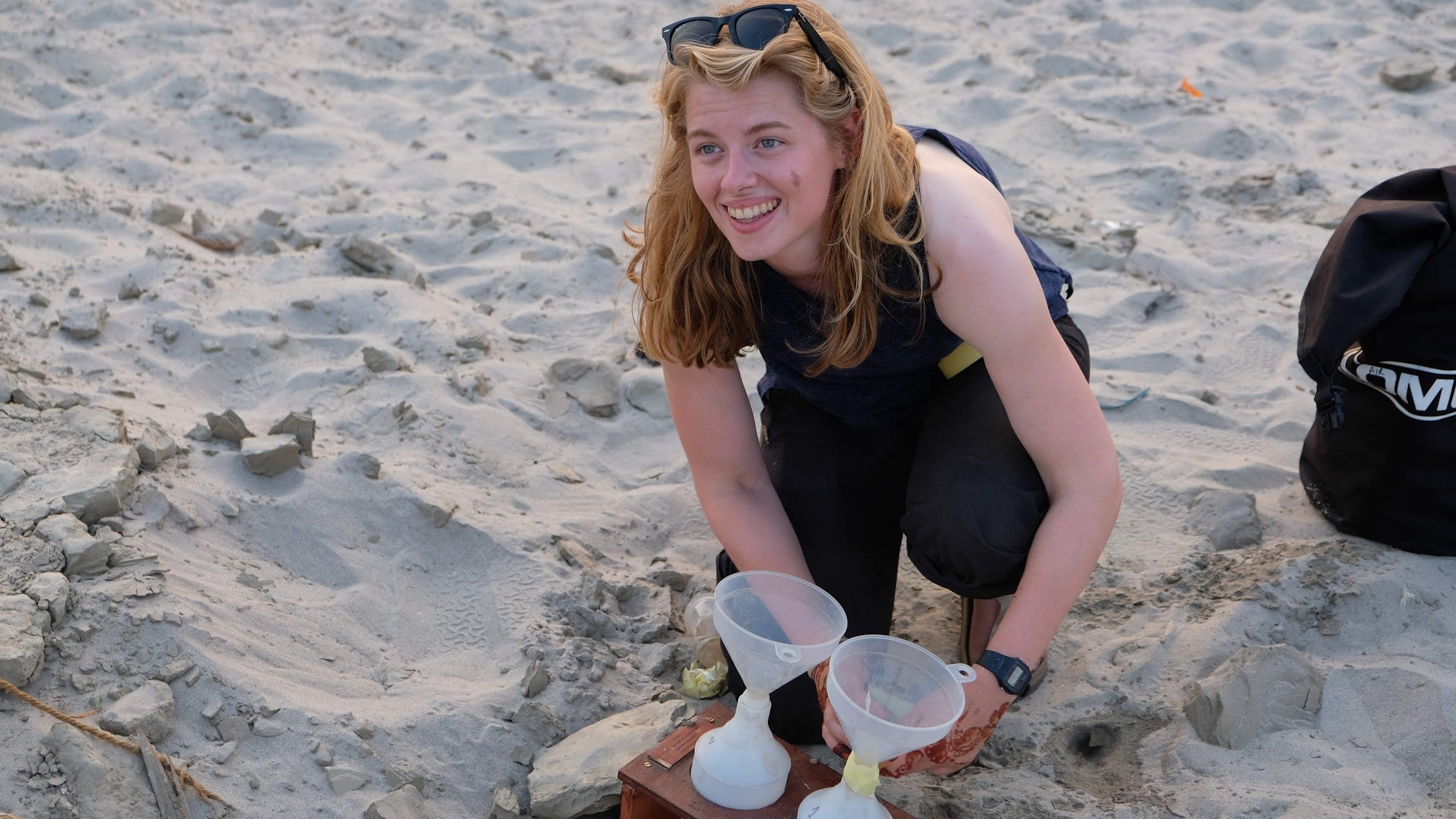 Dr Imogen Napper searching for plastic particles on a beach