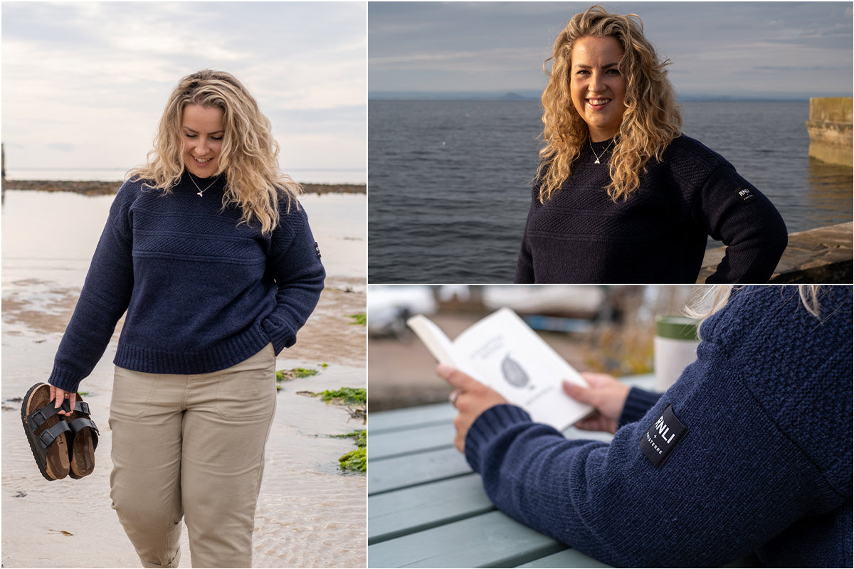 Emily Hague wearing the RNLI + Finisterre Gansey Jumper at her local beach