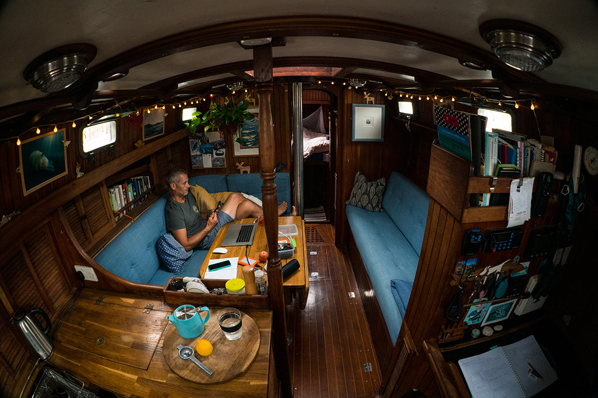 Tom Luddington sits in the cabin of Noctiluca