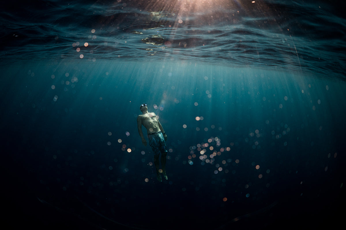 Underwater images of Tom Luddington diving in crystal clear waters