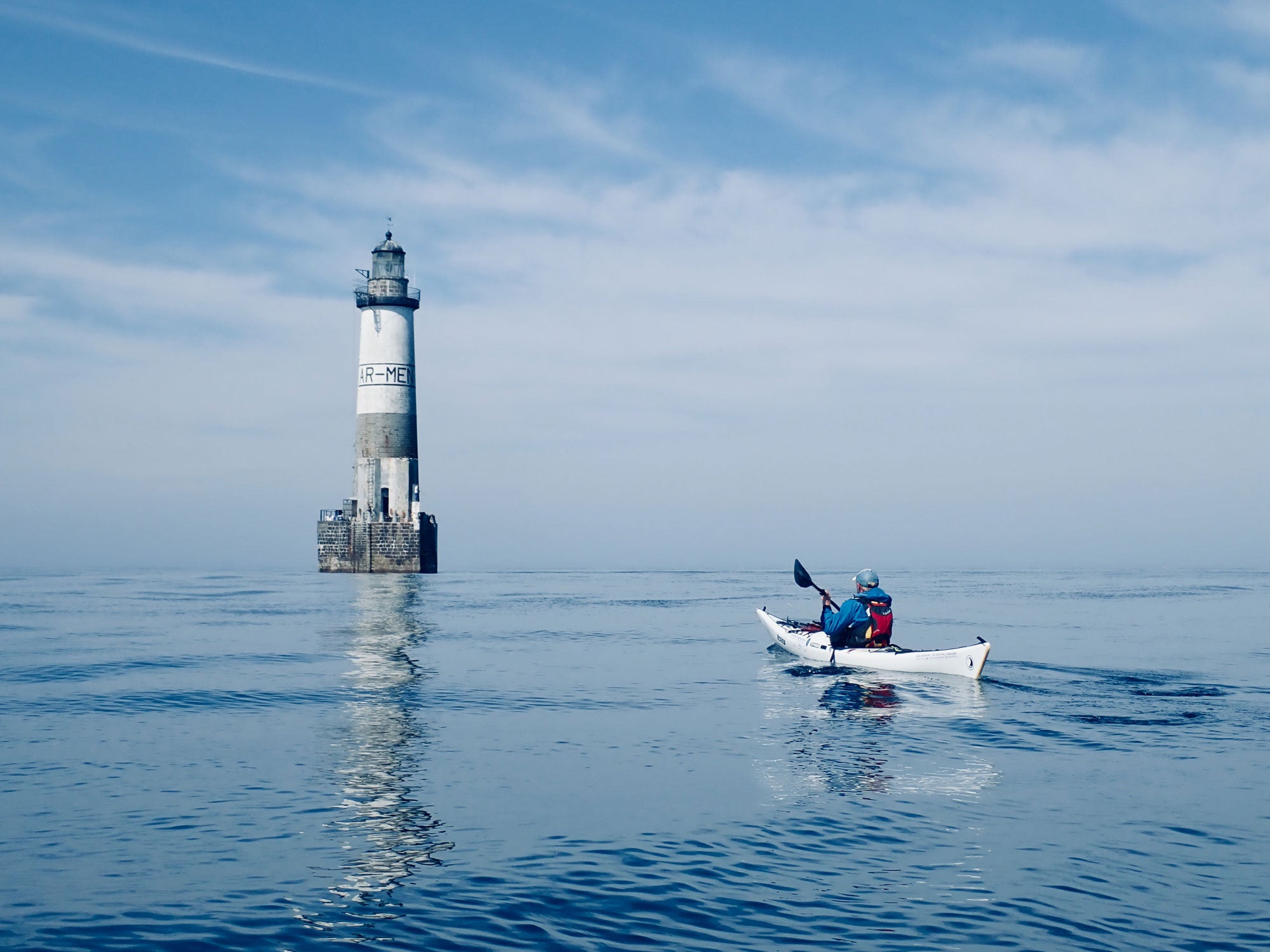 Toby paddling towards a lighthouse in France - Toby Carr - Moderate becoming good later