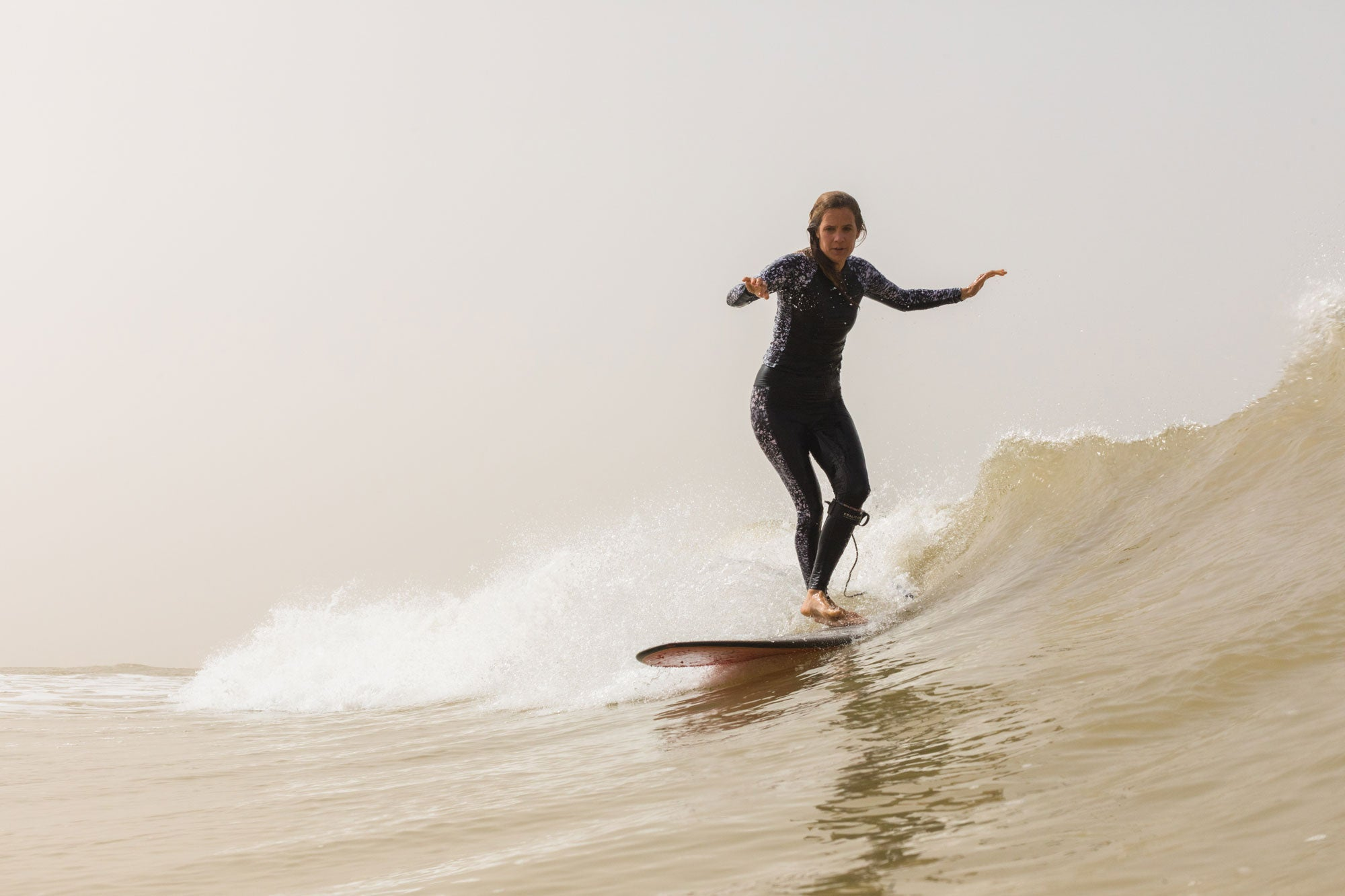 Head-of-Finisterre-repairs-Amy-Brock-Morgan-with-some-smooth-cross-stepping-on-her-longboard