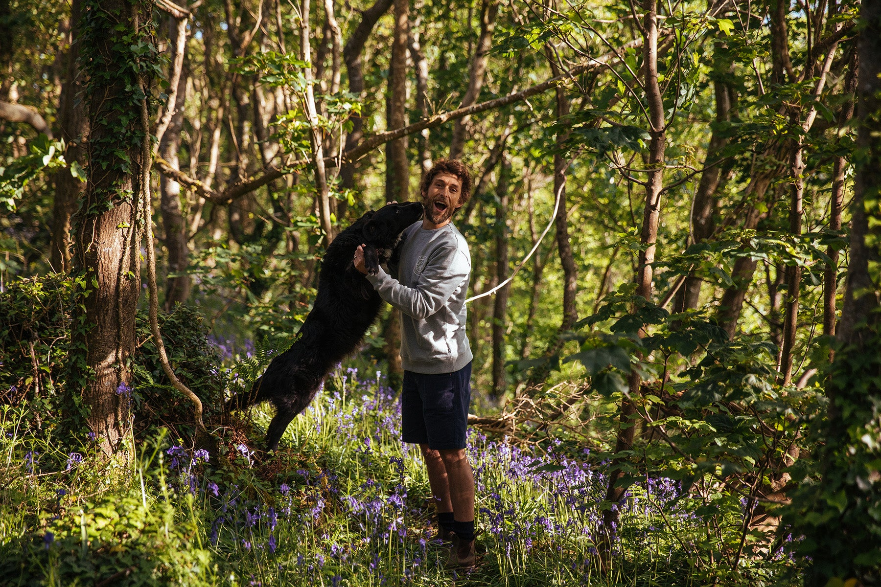 James Bowden and his dog Dillon in the woods near their home