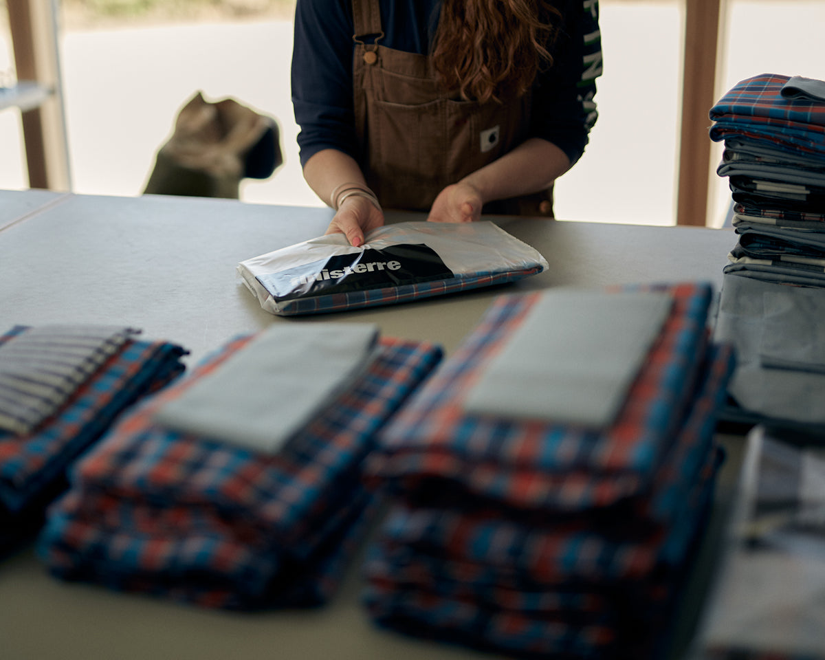 Ali Goodman prepares the packs to send out to volunteers making PPE for the Cornwall Scrubs Project