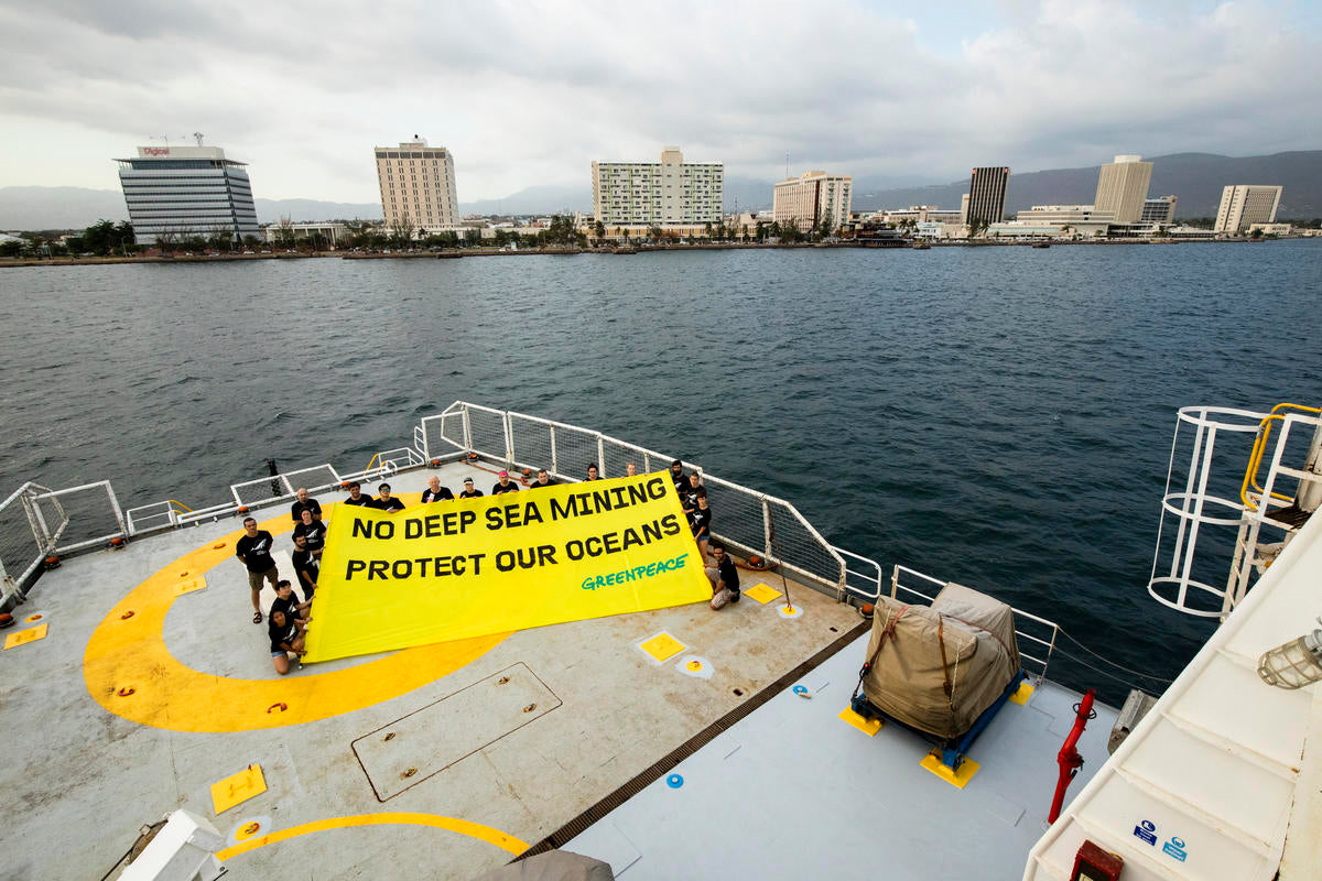 Jade Sellick - Crew displays a banner reading No Deep Sea Mining on the Greenpeace ship Esperanza in Kingston Jamaica