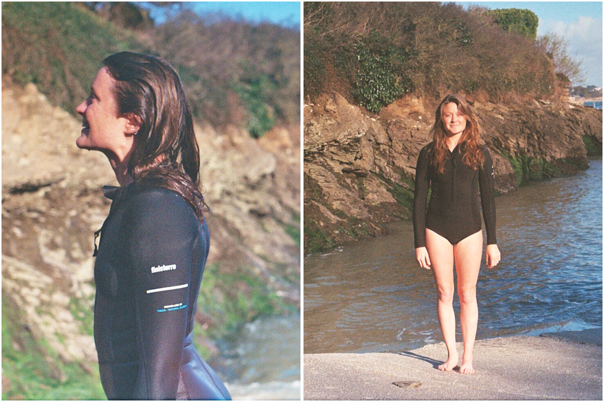 Lottie Lewis stands by the water before and after her swim wearing the Finisterre Yulex 2e Swimsuit
