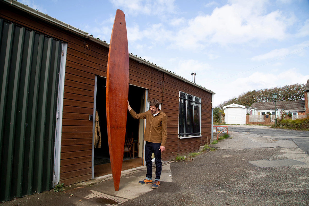 Mat Arney outside the Hailer Workspace wearing his new Palladium + Finisterre Boots