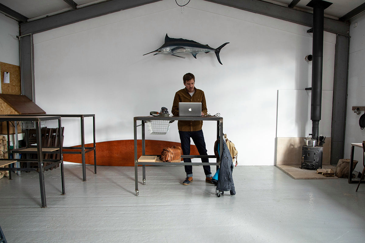 Mat Arney wearing Palladium + Finisterre boots in the office