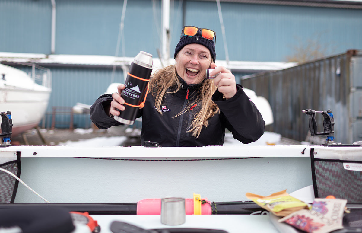 Mary is all smiles drinking from her Finisterre thermos as she inspects the boat Fenris