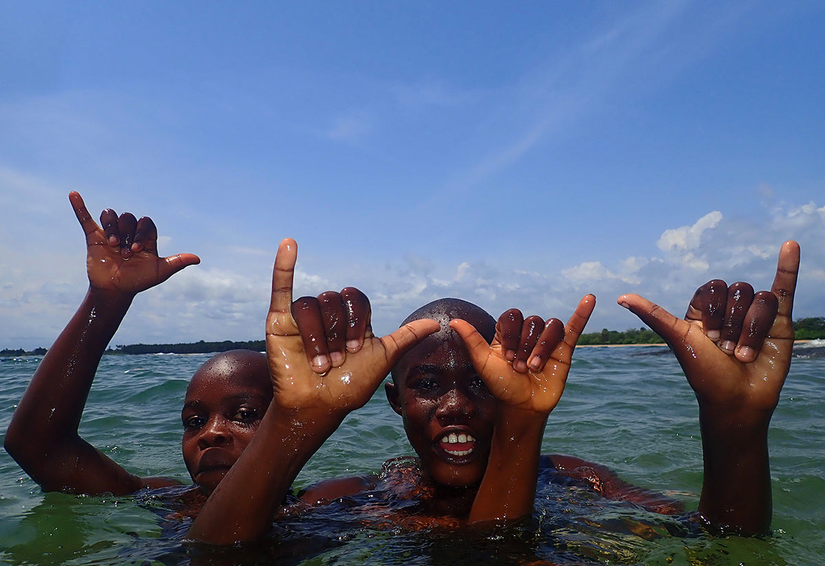 Young Wave Alliance participants throwing up some shakkas from the water