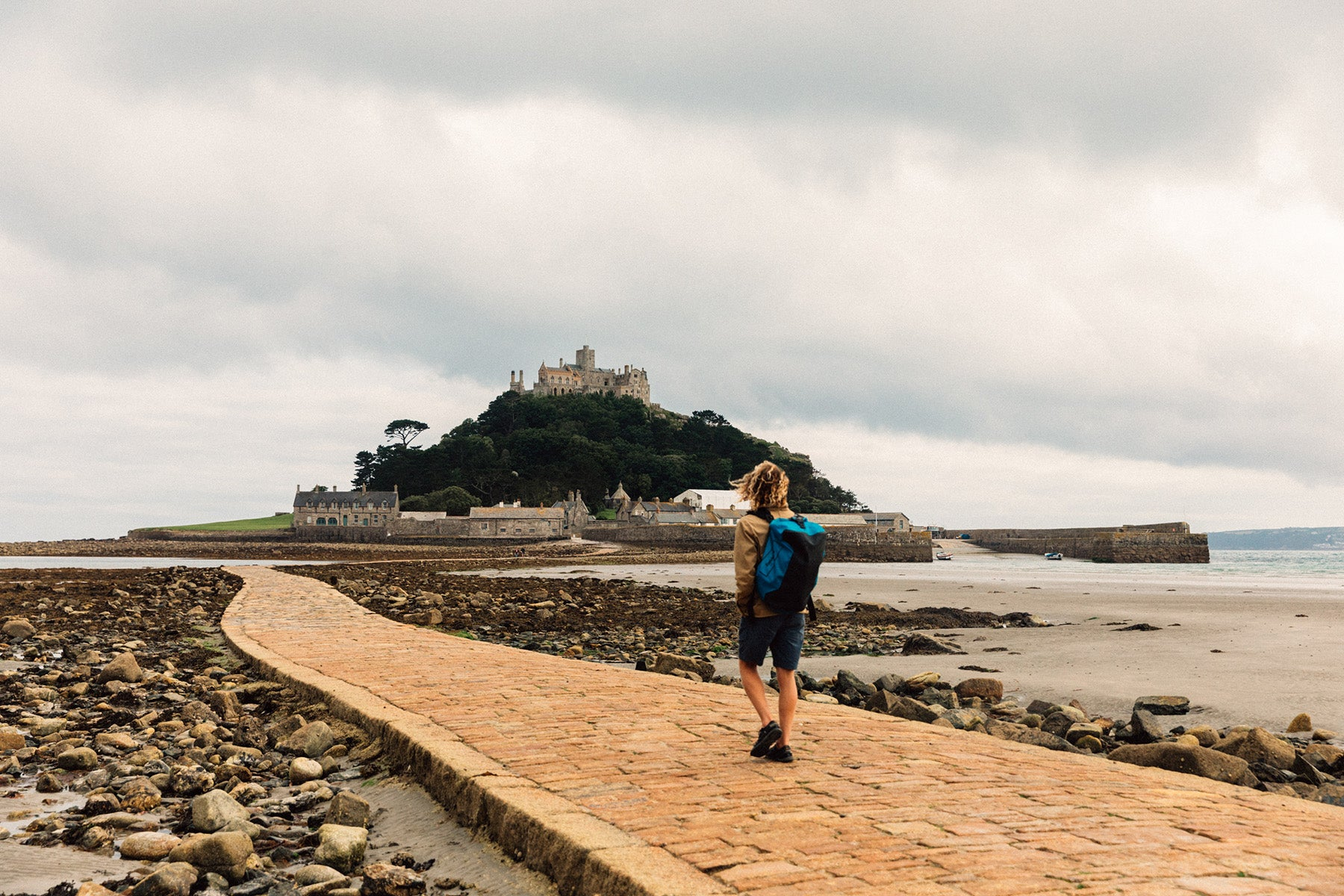 The Author Pete Geall walking the stone causeway to St Michaels Mount in Mounts Bay