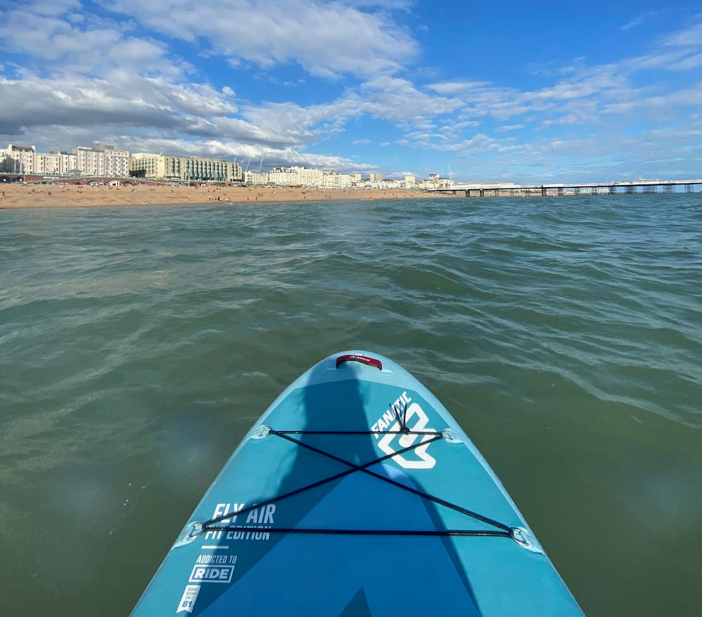 View of Brighton beach from a paddleboard.
