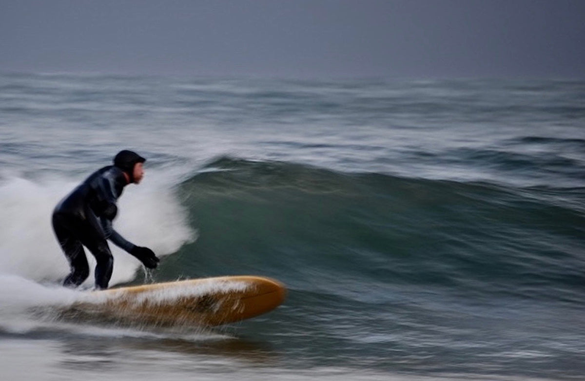 Rich Hardy surfing in the depths of winter