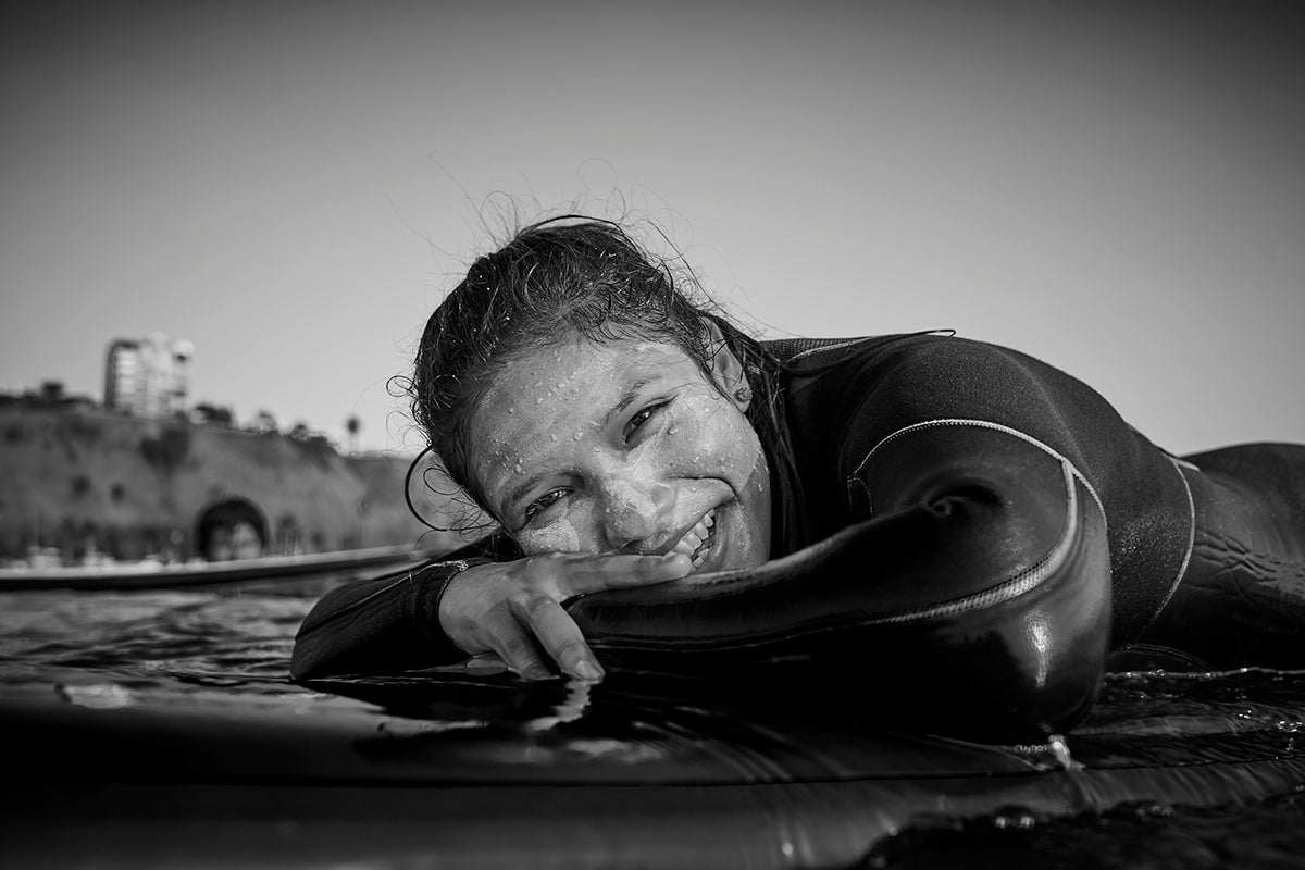 A Wave Alliance participant from the Alto Peru program smiles in the water