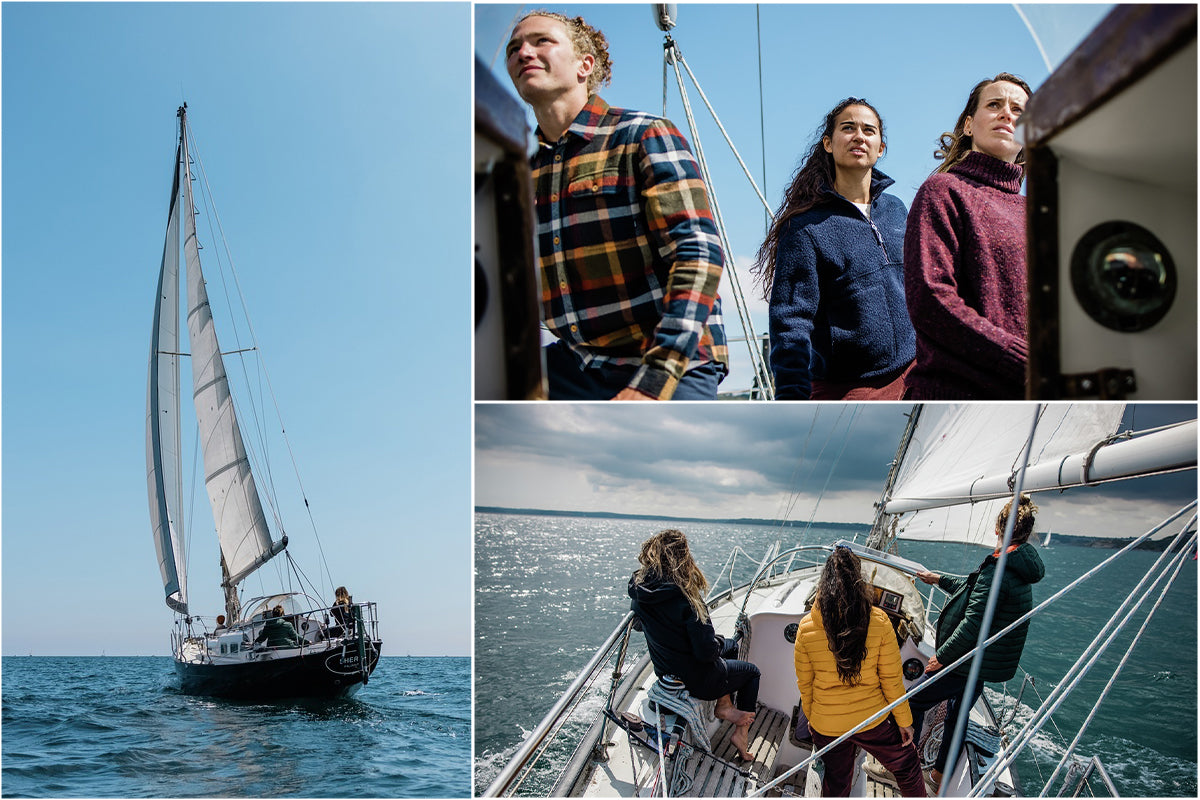 Chloe and friends sailing calm seas in cornwall wearing Finisterre clothing