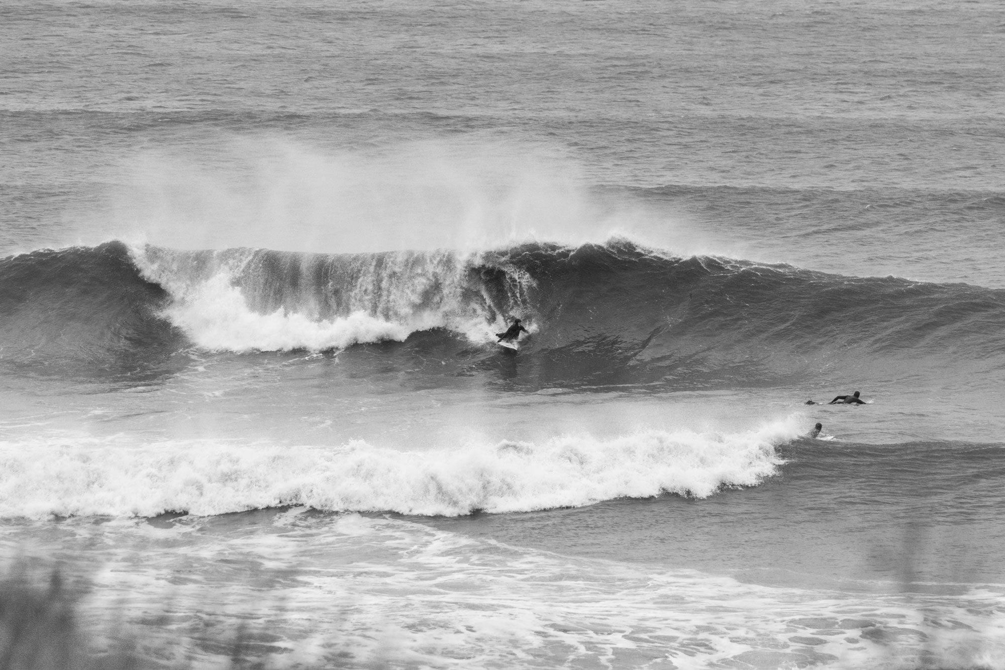 Sally McGee surfing in the cold waters of the North East