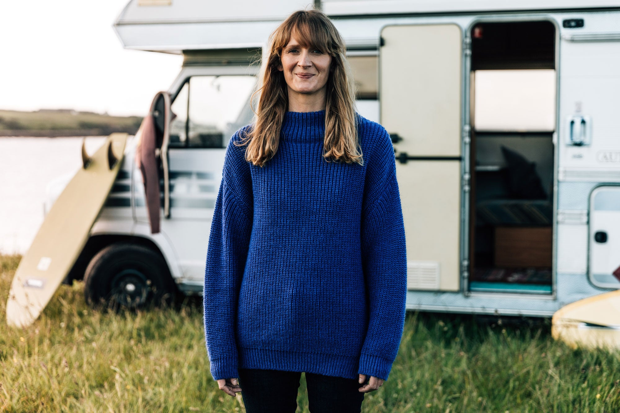 Sally-McGee-with-her-surfboard-and-camper-van