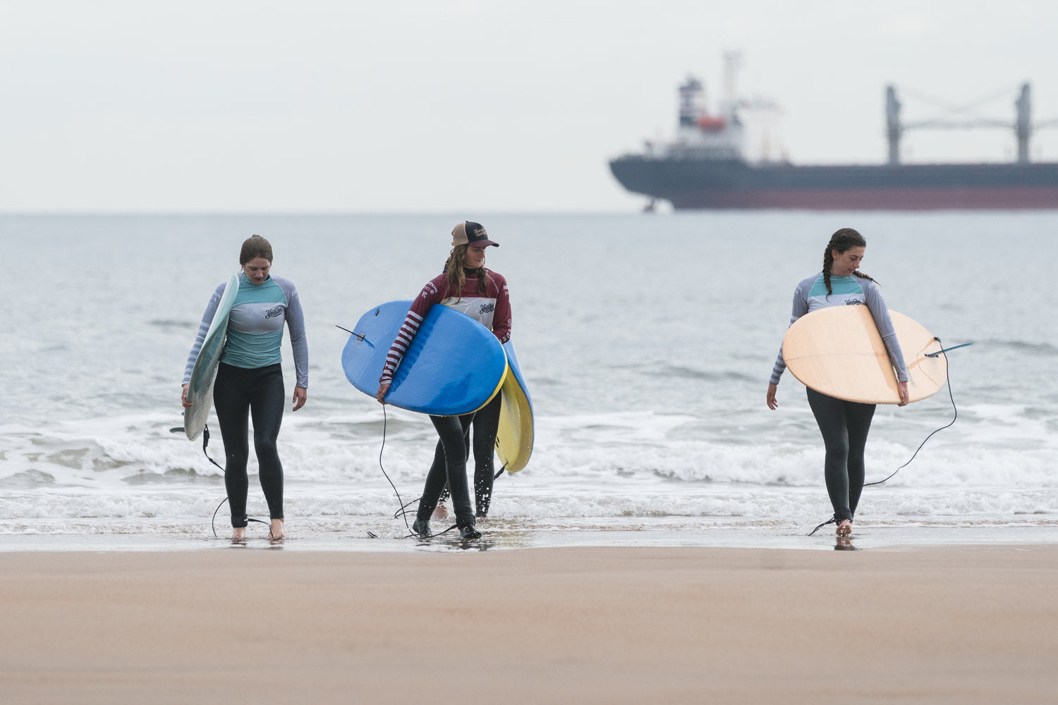 Sally McGee emerges from the water after teaching a surf class with the girls from Yonder - Image Credit Tom Bing