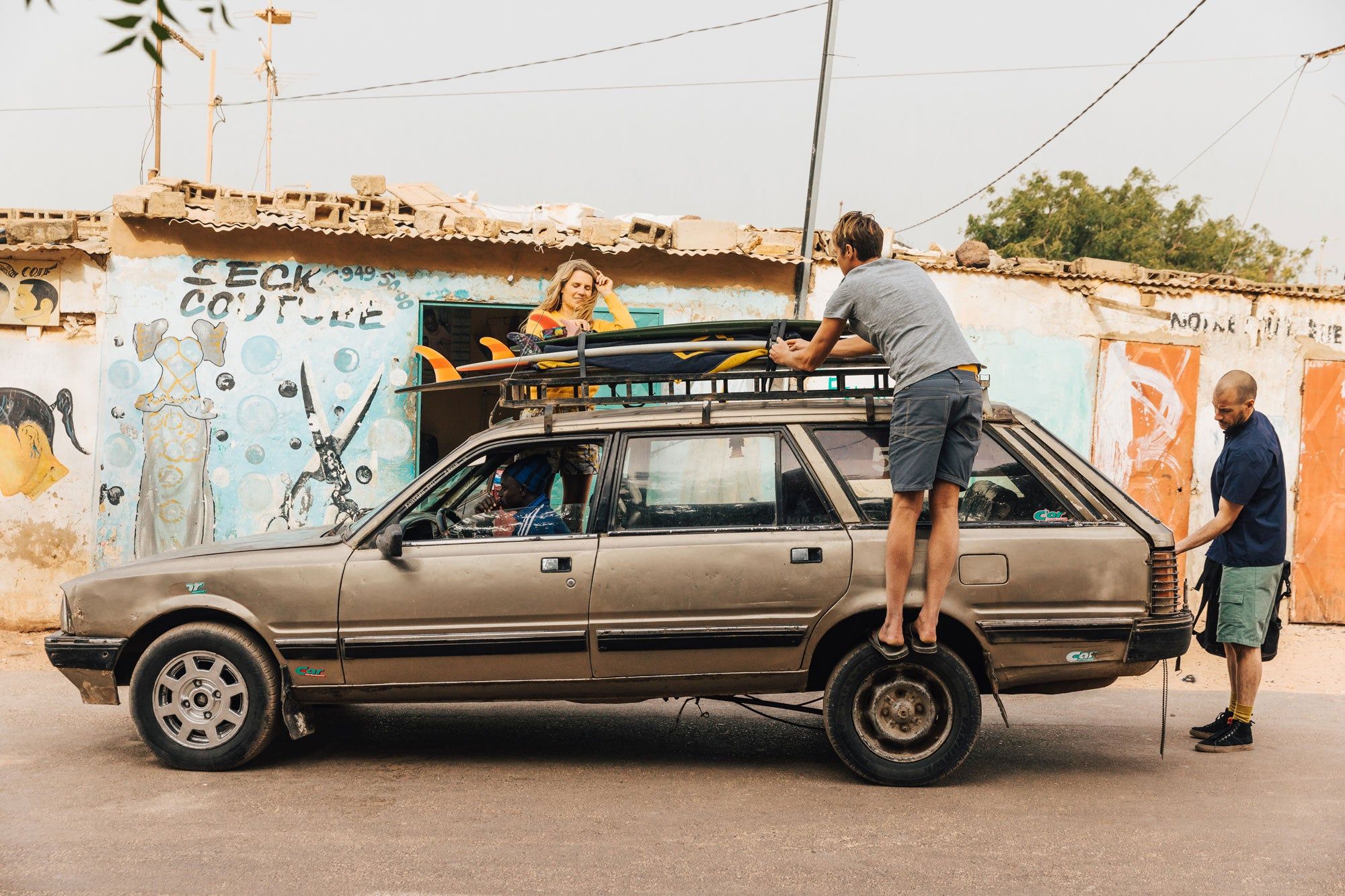 Sam-Bleakley-Noah-Lane-and-Amy-Brock-Morgan-packing-up-the-Finisterre-Surf-mobile-on-our-2019-Senegal-trip