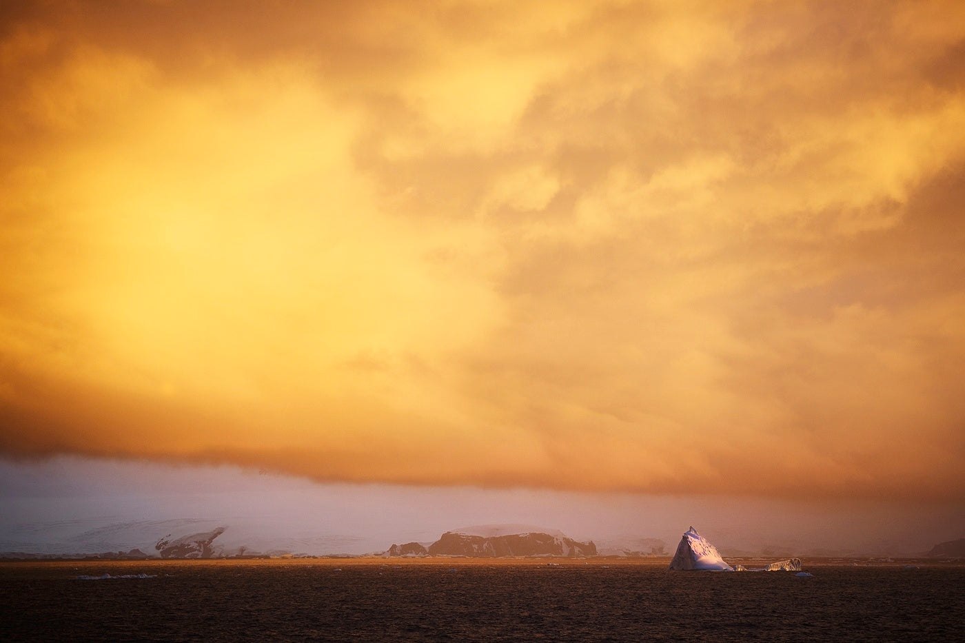 Sunlight in Antarctica creating a vivid orange sky above the continent
