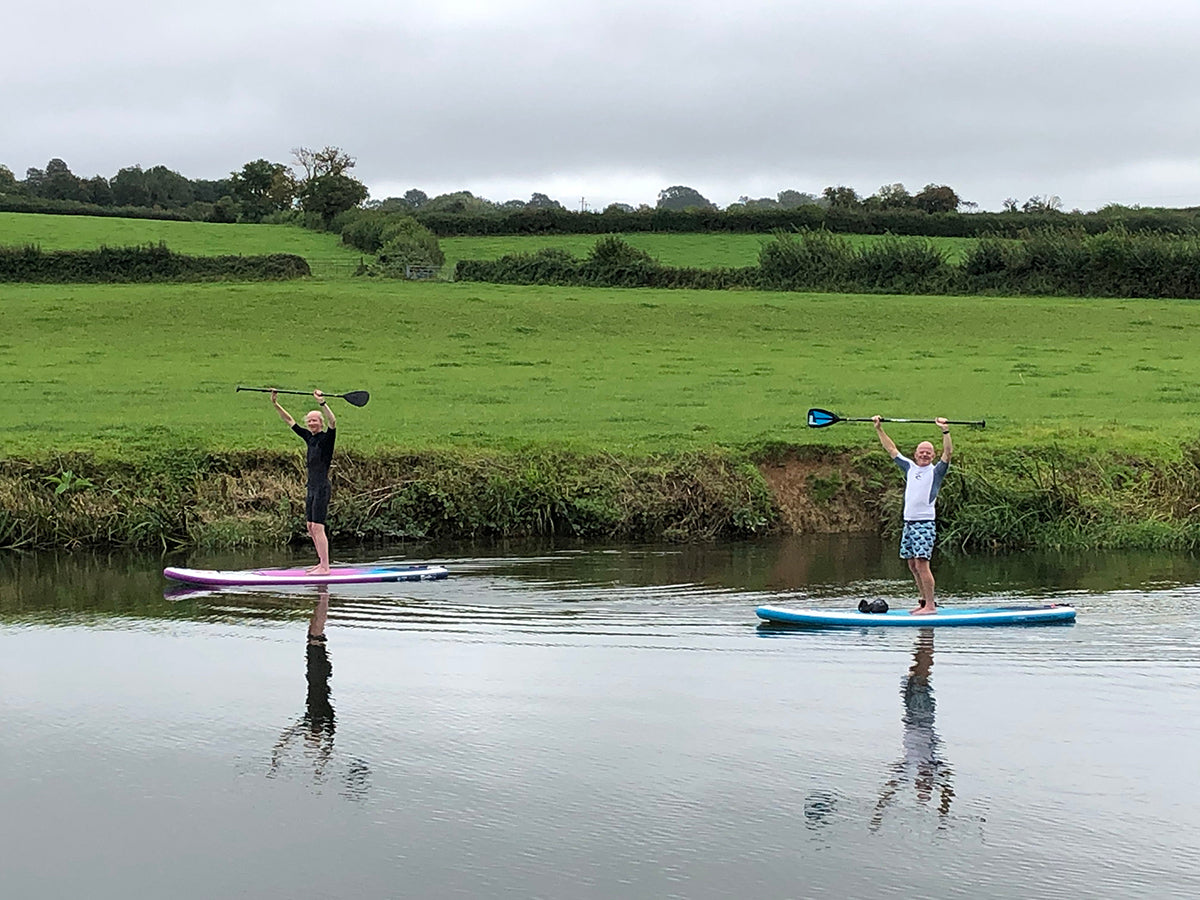 Phil Williams and a friend Stand Up Paddleboarding down south