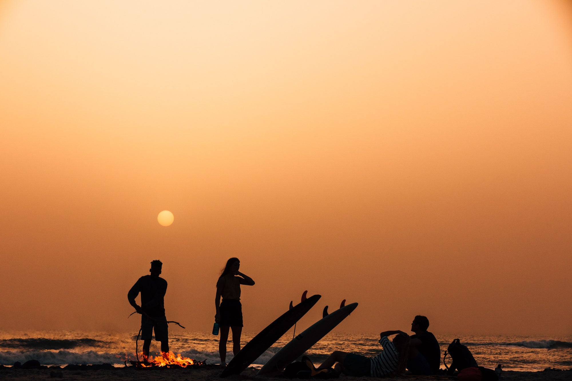 The-Finisterre-crew-relax-and-watch-the-sunset-after-a-full-day-session-in-Senegal