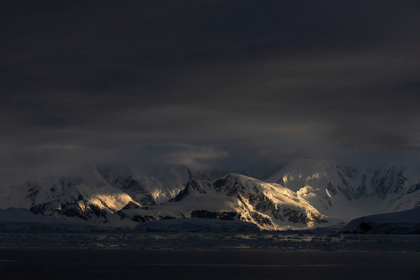 The continent of antarctica looking moody in the dawn light