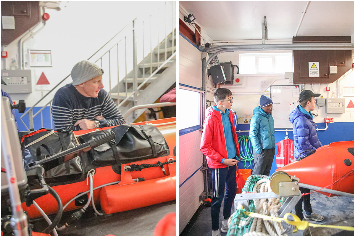 Tom Kay gives the group from Get Exploring Trust a tour of the St Agnes Lifeboat station