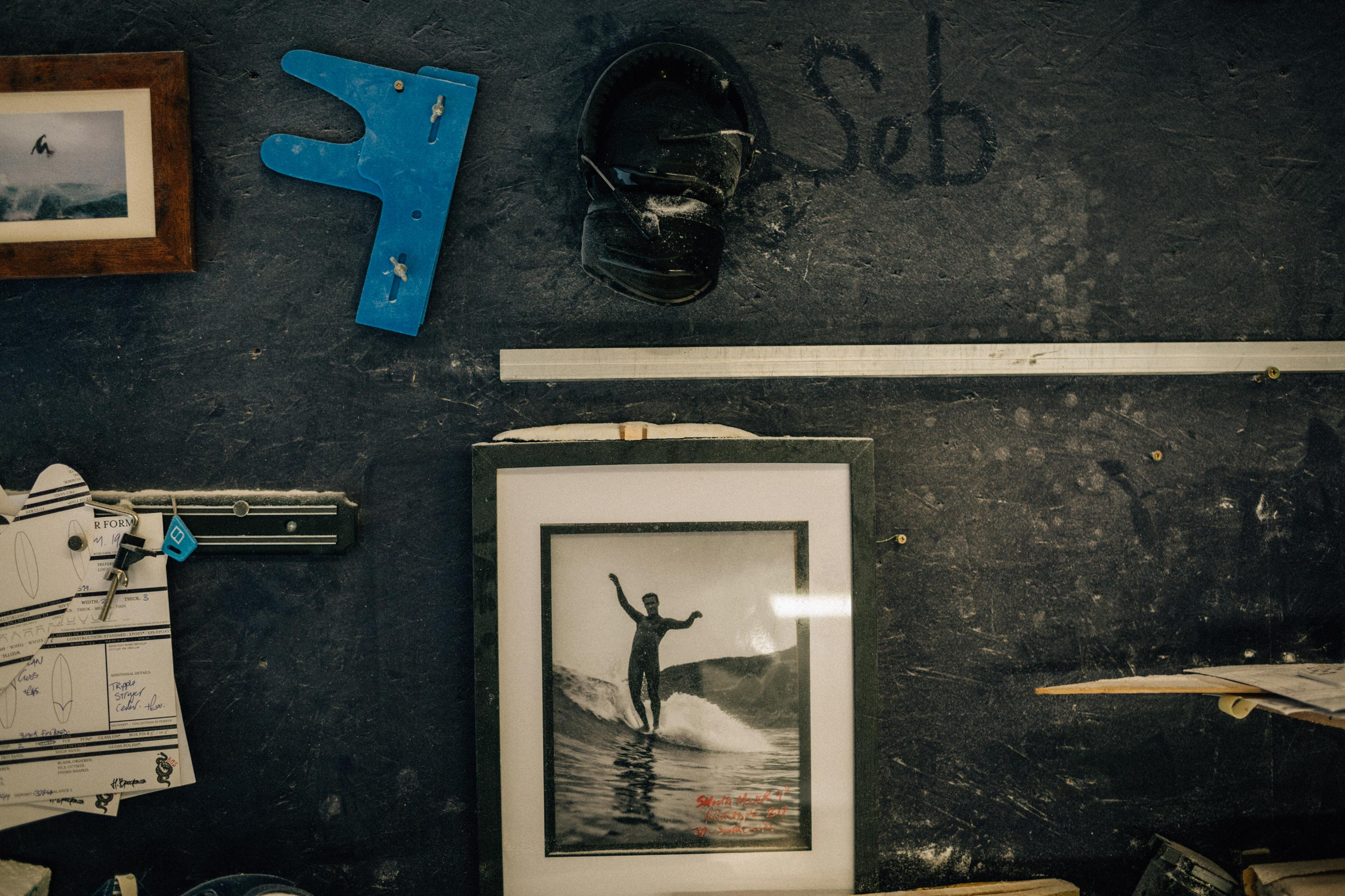 Vans + Finisterre editorial - Assorted shaping tools in James workshop and a framed picture of Josh Daniels founder of Smooth Movers competition