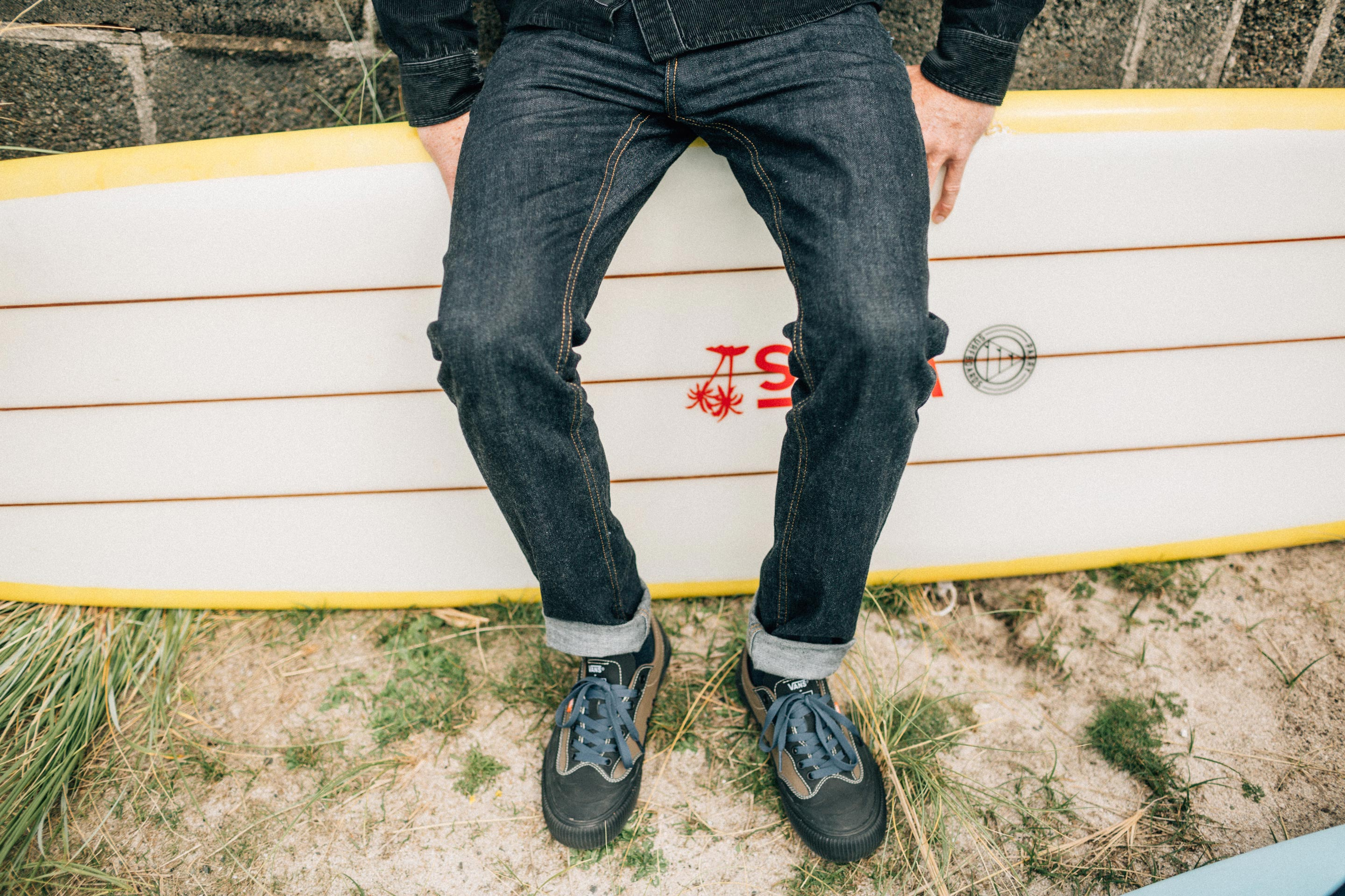 Vans + Finisterre editorial - James Parry with his longboard and his new vans destruct shoes