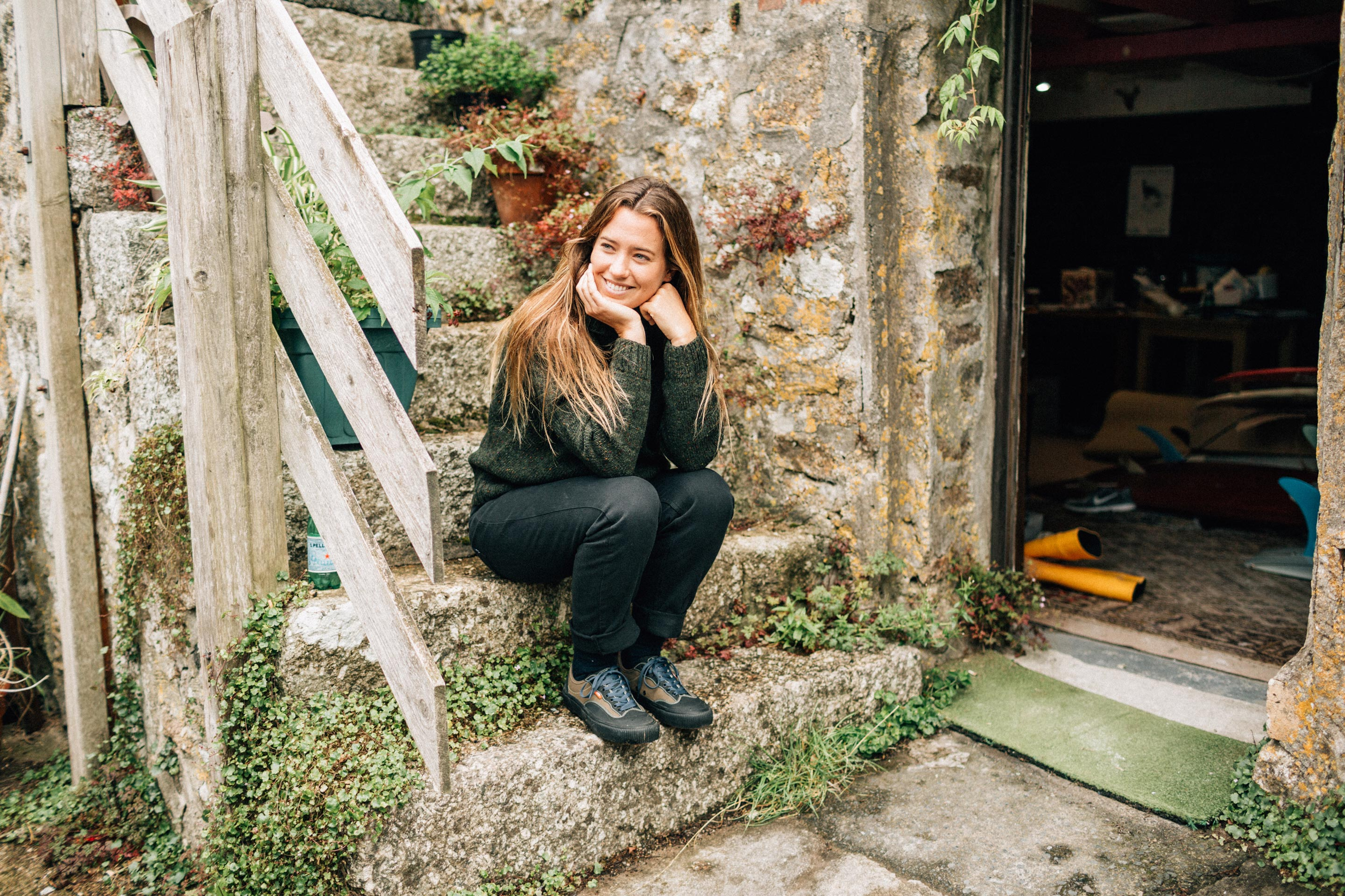 Vans + Finisterre editorial - Paige Maddison sat outside the workshop