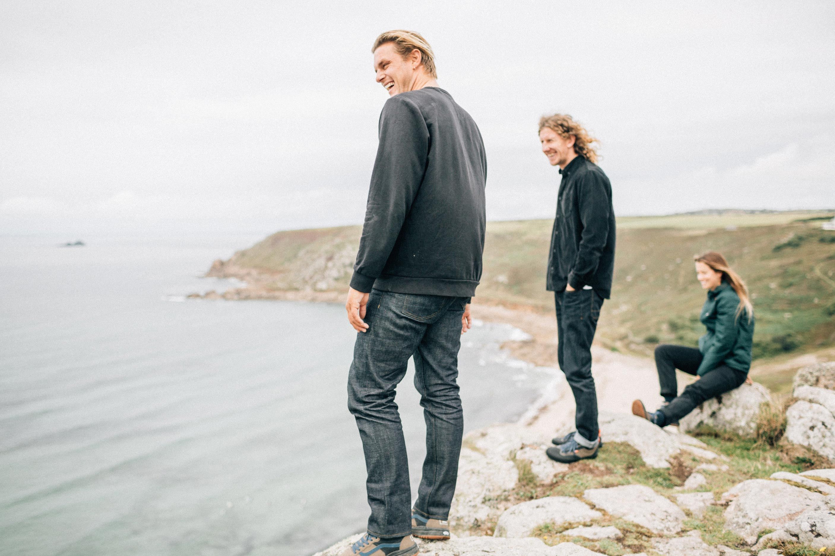 Vans + Finisterre editorial - Seb Smart, James Parry and Paige Maddison looking out over Sennen cove from the cliff-top
