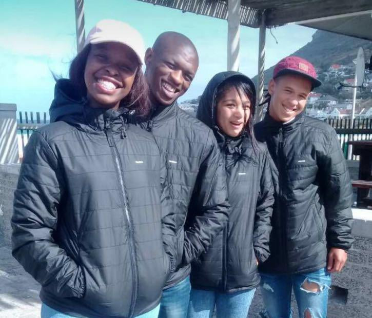 Kids from the Waves for Change programme in South Africa wearing their new Nimbus Jackets with pride