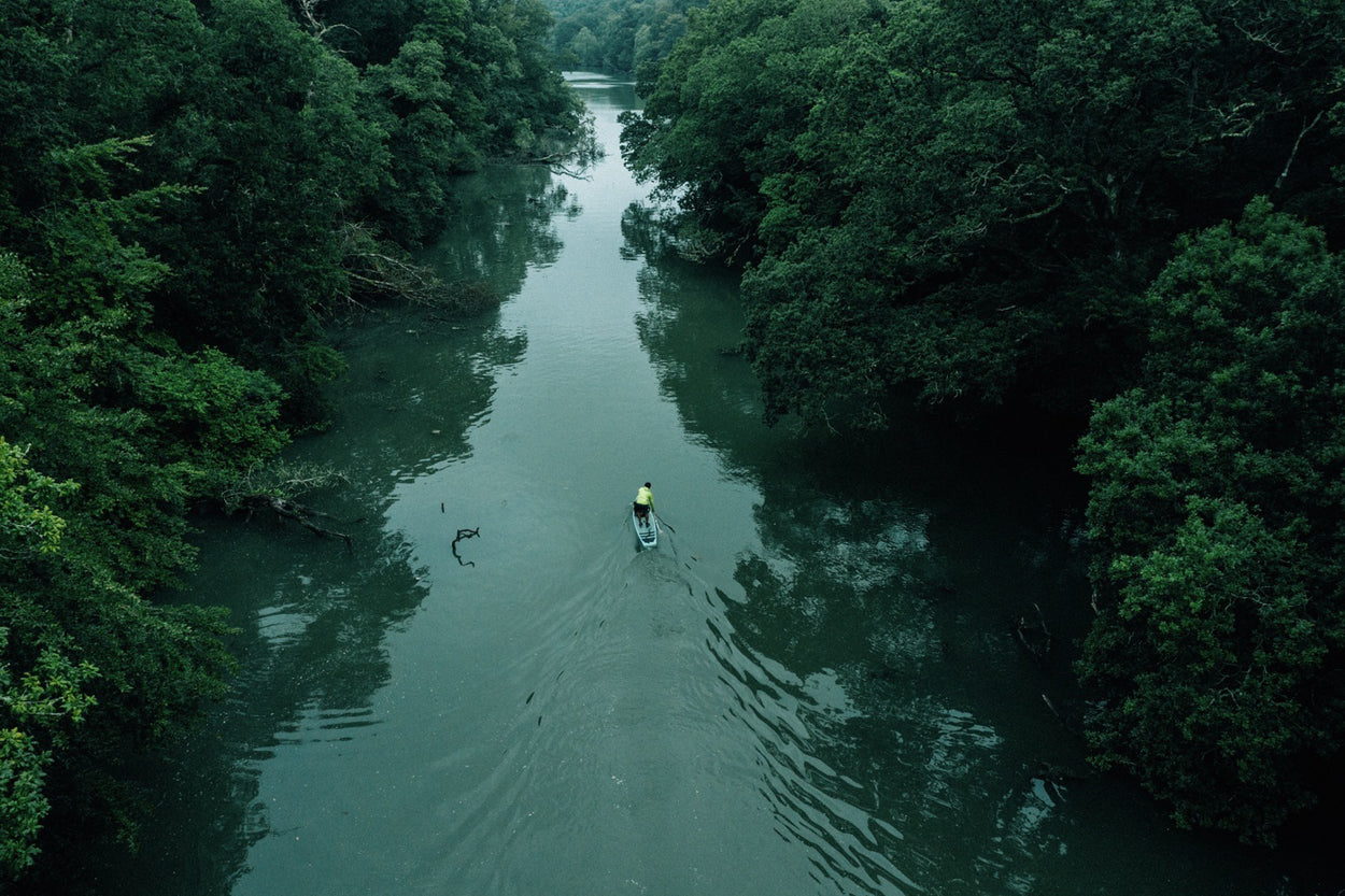 Aerial shot of a Paddleboarder on the Helford river